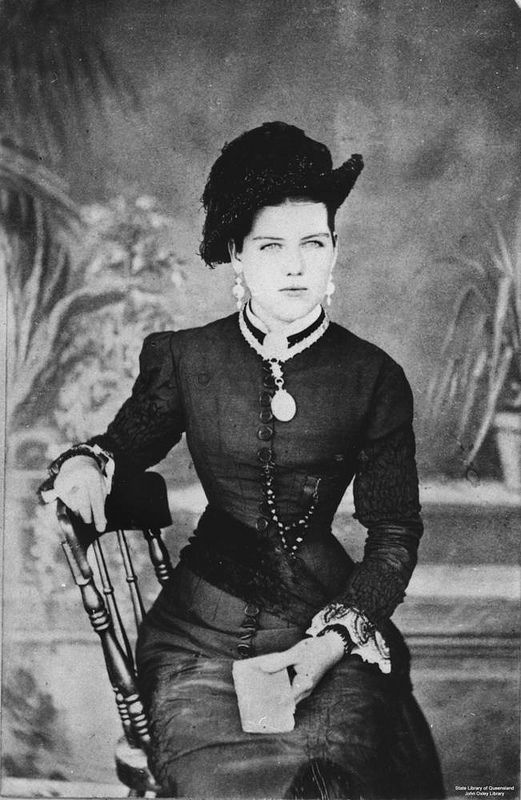 Photo of Studio portrait of Elizabeth Plane seated in a chair at Cooktown, Queensland, 1880-1890