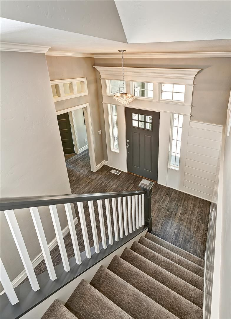 Entryway With Gray Stair Rail And White Balusters Gray Door And   White And Grey Banister   Newel Post   Narrow Awkward Staircase   Stair Railing   Entryway   Wall