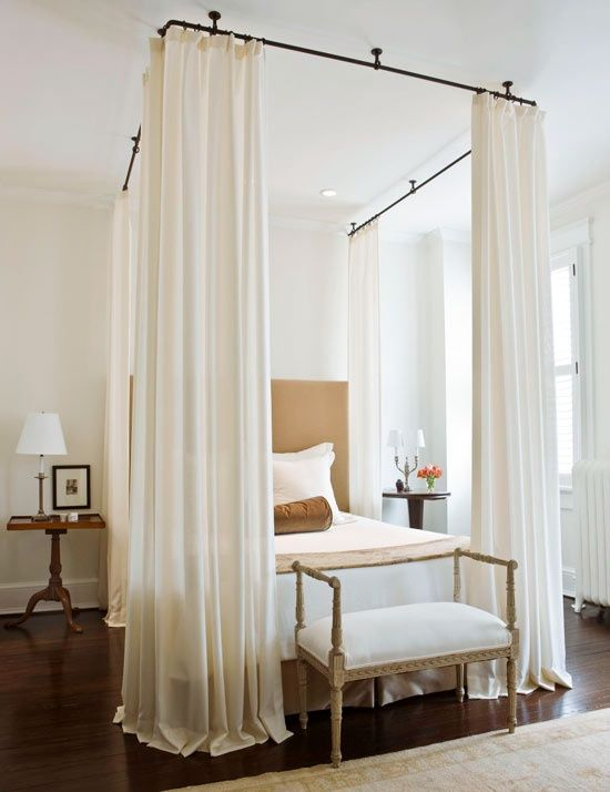 Elegant White Bedroom Iron Rods Attached To The Ceiling Hold