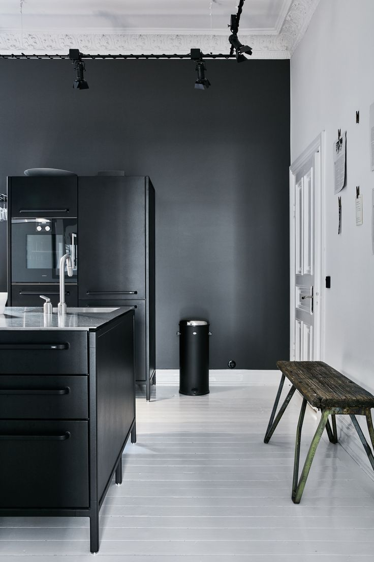 Black modular kitchen island and cabinet from Vipp with stainless ...