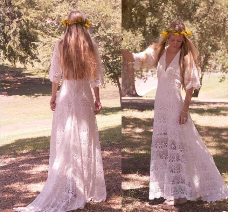 Bruidsjurk bohemien model van kant met half lange mouwen