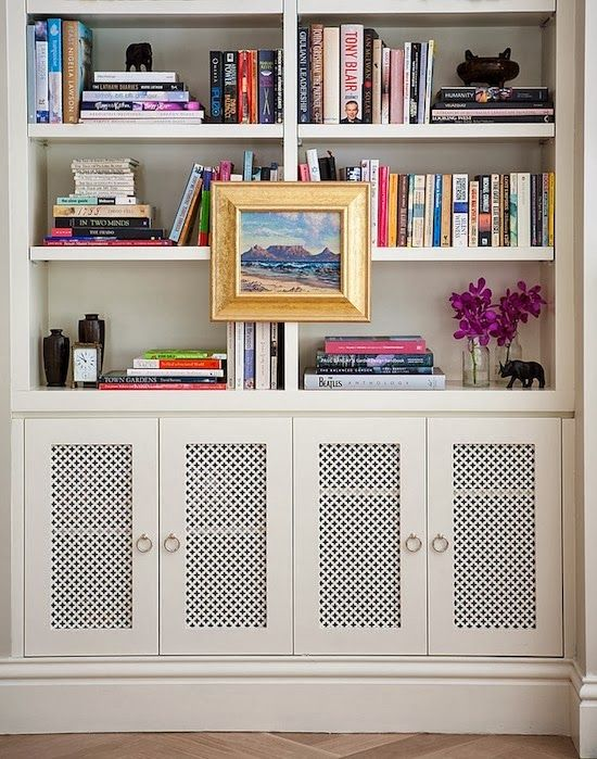 styled bookshelves with vented bottom cupboards for speakers, electronics, or radiators. Use thin layer of drywall on underside of shelf to keep the heat from radiating through the rest of the shelf