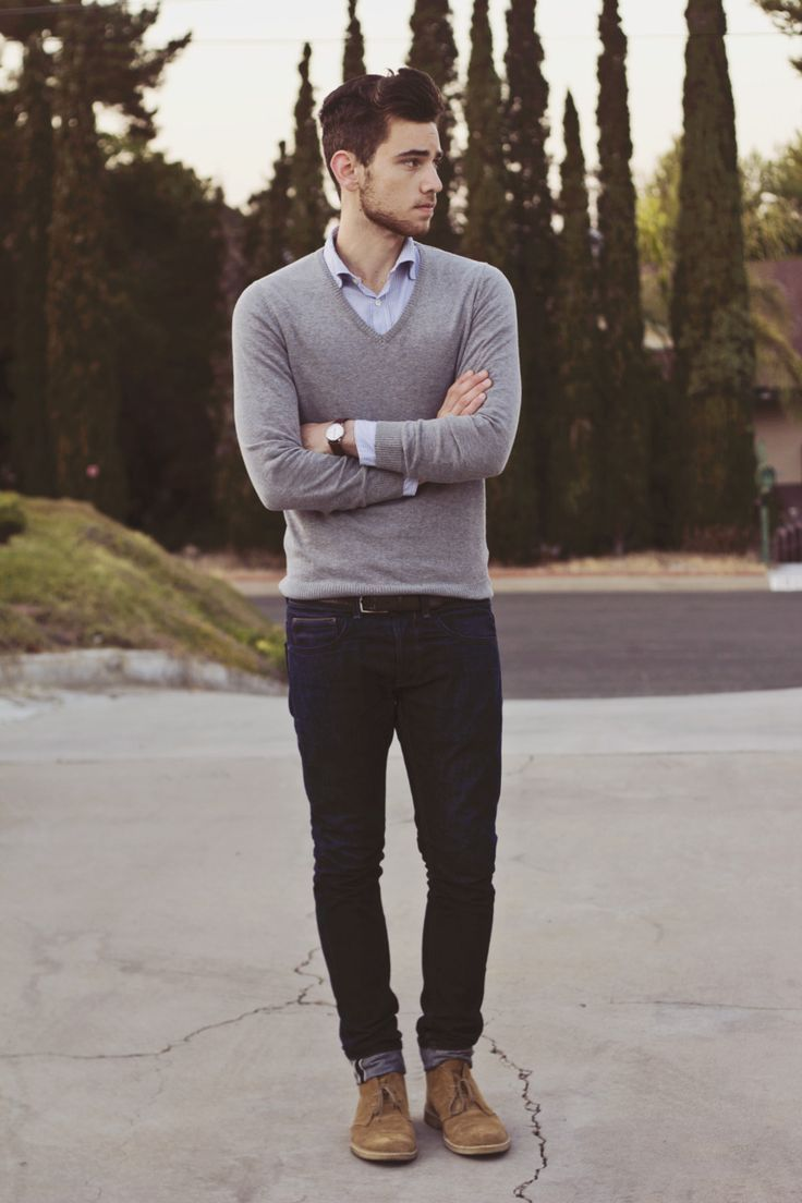 Rolled up dark denim paired with grey sweater, style for men.