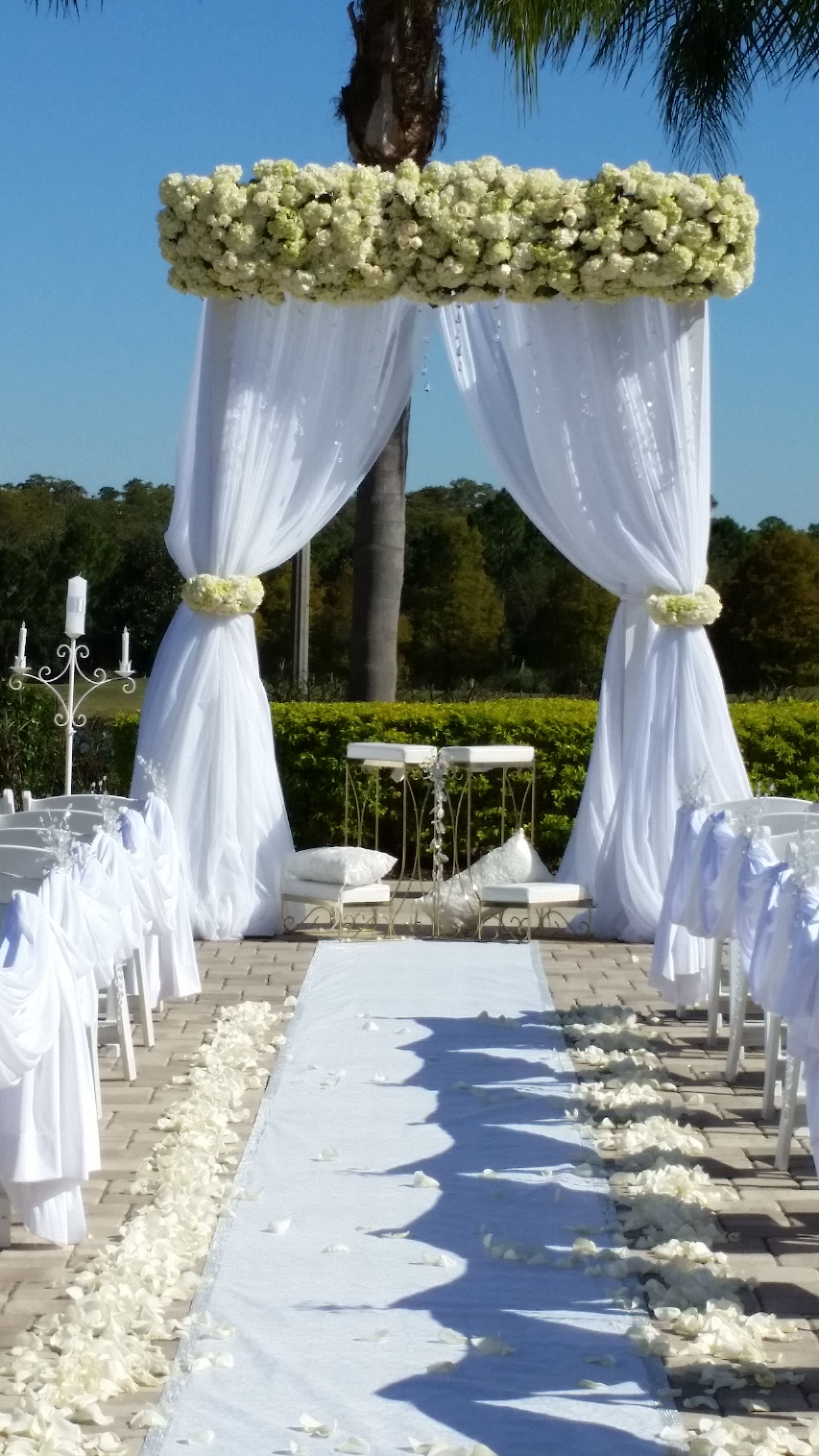 Aisle Lined With Rose Petals And D D With White Fabric