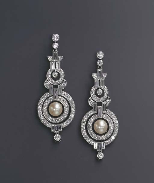 A PAIR OF ART DECO NATURAL PEARL AND DIAMOND EAR PENDANTS -  Each designed as an articulated series of diamond collet and baguette-cut diamond geometric links, the old European-cut diamond concentric circle pendant centering upon an independent pearl, measuring approximately 8.95 mm, mounted in platinum, circa 1930