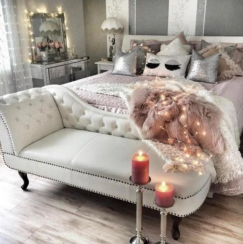 a creamy leather bench and a dusty pink faux fur blanket, a mirrored ...