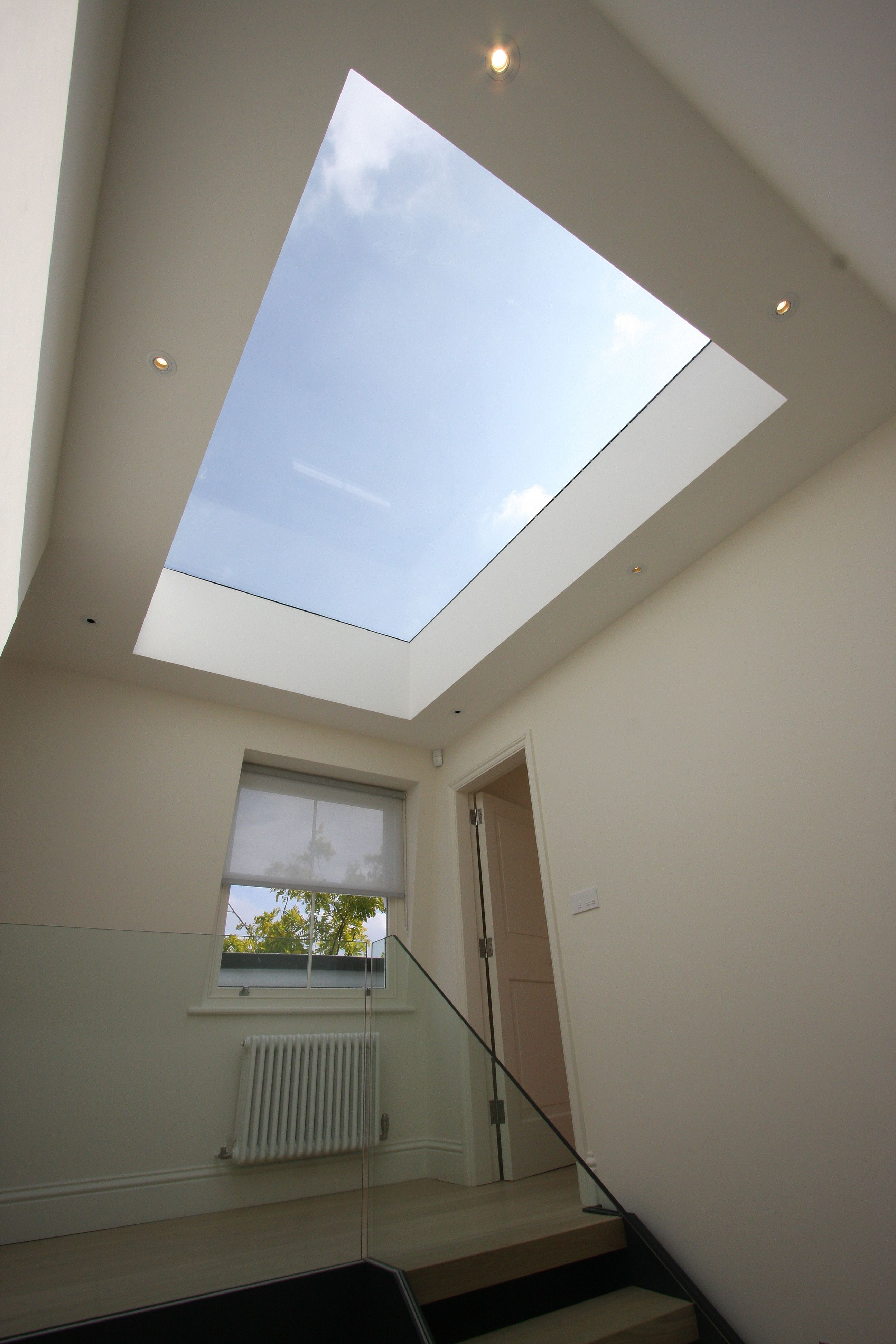A Rooflight To The Top Of The Stars Allows Lots Of Light To Enter The Staircase Void The Use Of Glass Balustra Flat Roof Skylights Roof Light Flat Roof Lights
