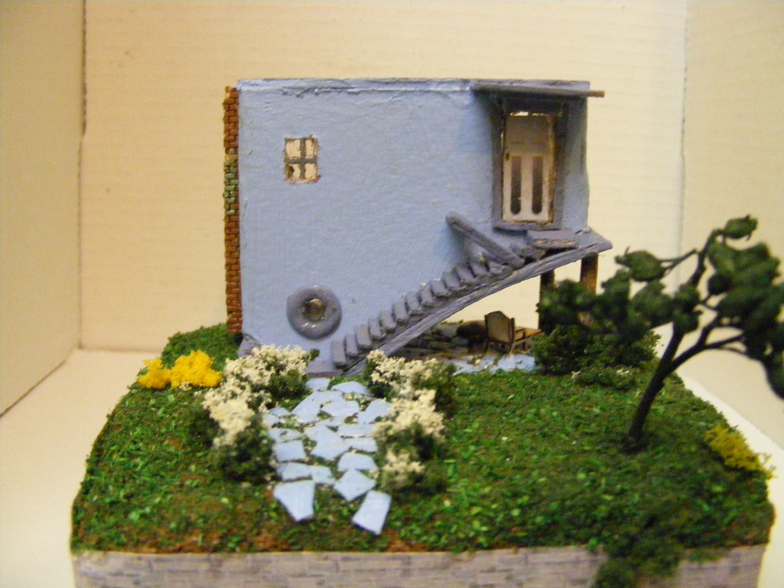 """Upside down house 1/144"""" scale - Another lady made the house and I furnished it. (by Donna Post)"""