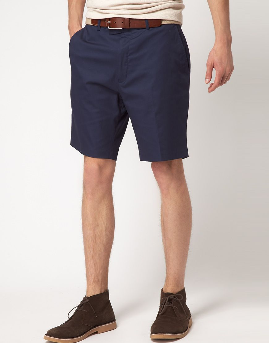 Chino shorts by Vito. Constructed from stretch cotton. Featuring a top button fly, belt loops, side slant pockets, standard hem, three pockets to the reverse and a regular fit.  [$69.32]