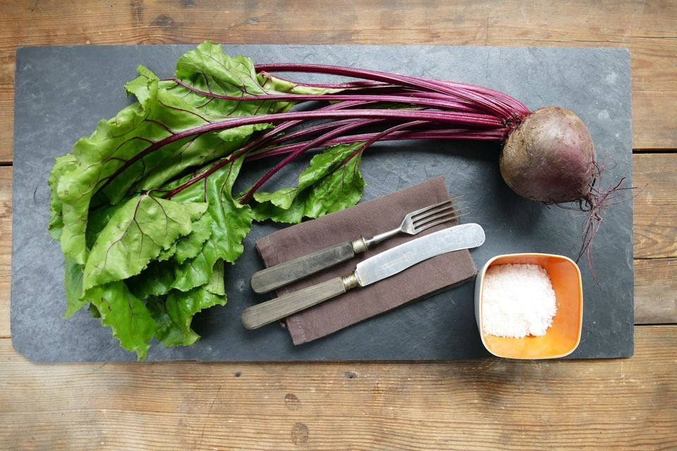 High Angle View Of Common Beet On Slate Over Table