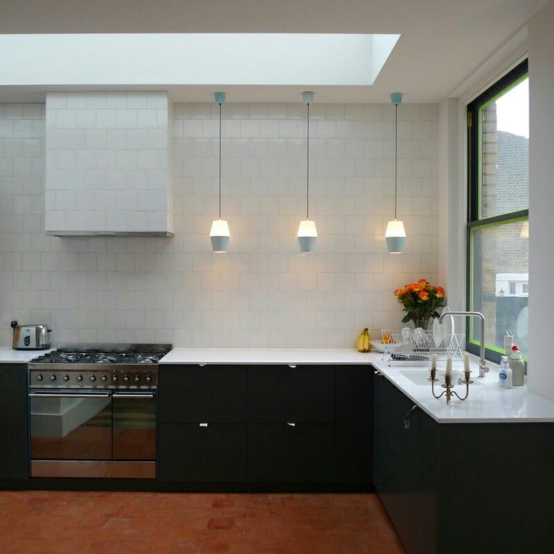 Kitchen With Dark Units And Reclaimed Quarry Tiles By Georgina Mann Www Mosleyandmann Co