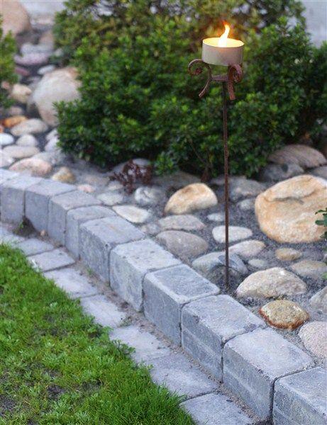 Concrete Patio Edge Ideas: River Rock Set In Concrete With Space For Small Shrub
