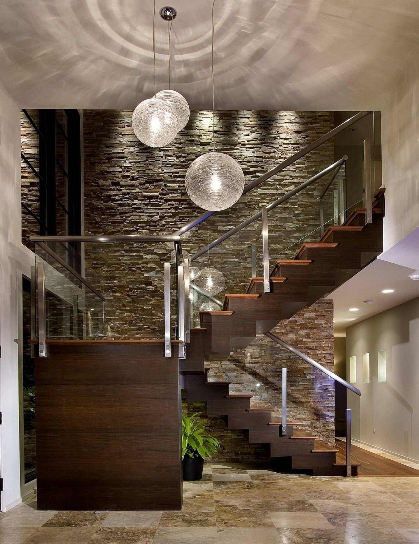 Extra high ceilings, glass stairwell, long chandeliers, enters ...