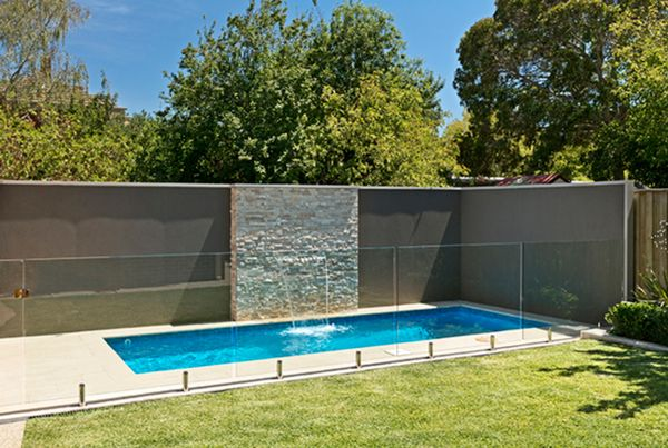 2 5 Metre Wide Rectangle Pool With Waterfall And Glass Pool Fencing In Lake Wendouree Desig Pool Landscaping Rectangle Swimming Pools Backyard Pool Landscaping