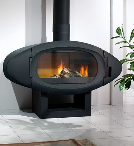 Made of steel, the minimalist round and oval wood burning stoves from  Cheminées Philippe fit - Made Of Steel, The Minimalist Round And Oval Wood Burning Stoves