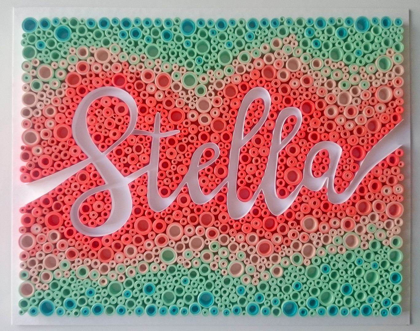 """STELLA, 3/8"""" quilling paper on white chipboard, in shades of coral, mint green and teal. JUDiTH+ROLFE"""