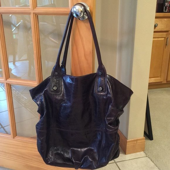 Large Dark Purple Handbag Super cute over the shoulder bag. This was used very little and still has the original tags. Abro Bags