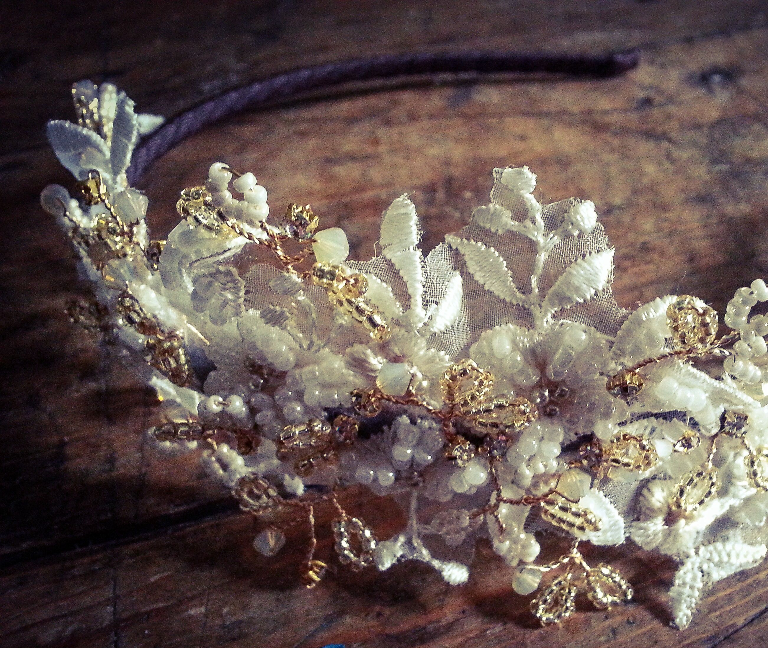 Vintage inspired headdress made from hand beaded lace, Swarovski crystals and diamanté in ivory and antique gold www.vintagebuttonbridaldesigns.co.uk