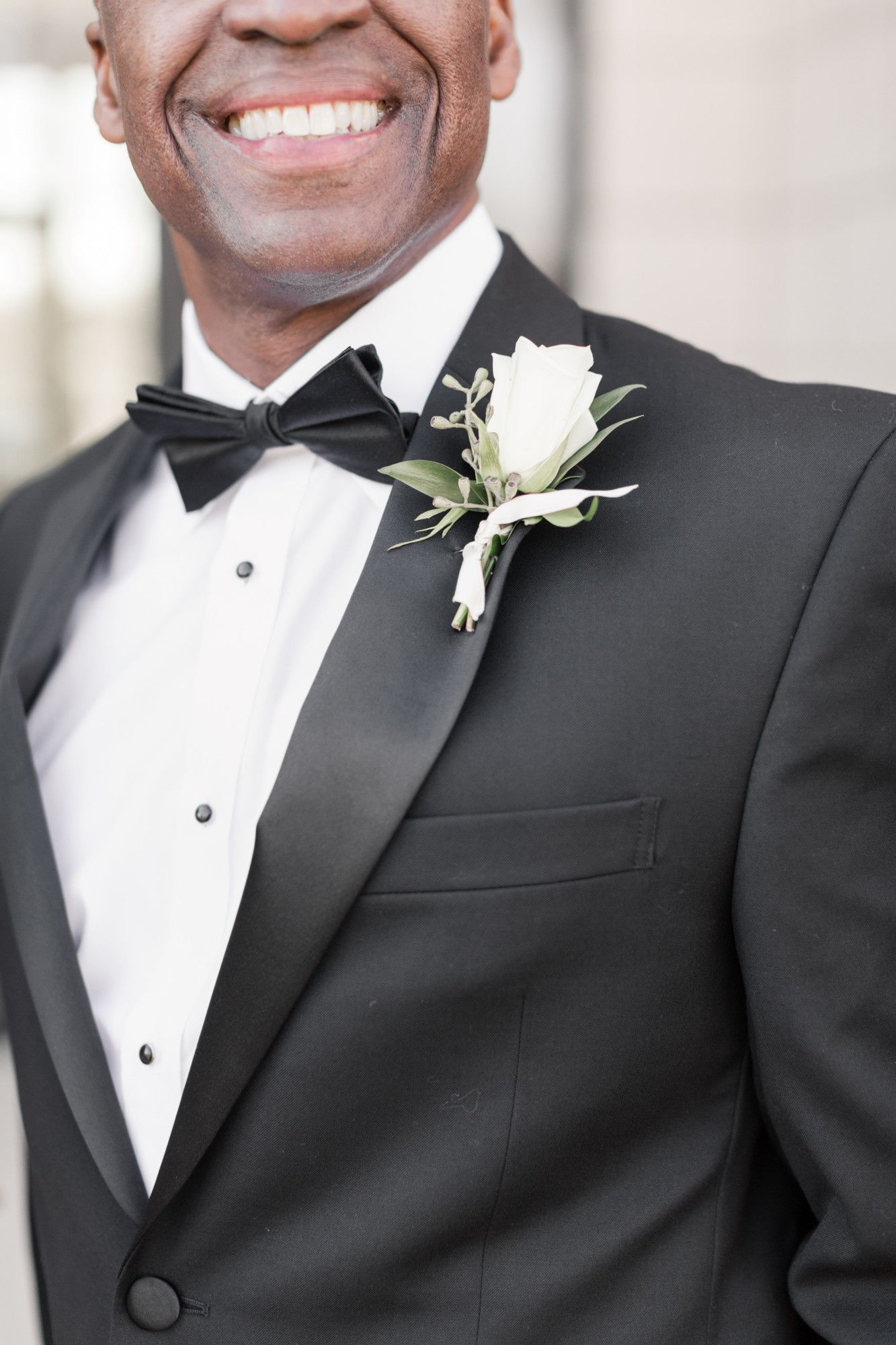 White rose boutonniere with a touch of seeded eucalyptus. Photo credit Kelly Ginn Photography