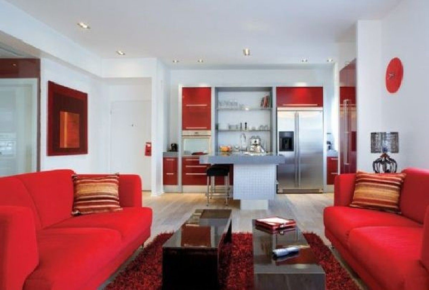 Apartments impressive open plan apartment design ideas with amazing red fabric sofas and gorgeous black long table combined soft red fur rug also wonderful