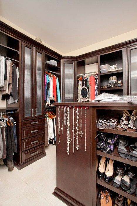 This Small Walk In Closet Demonstrate Efficient Use Of Space. It Has A  Combination Of Open And Closed Storage, Using Dark Mahogany Wood With  Frosted Glass ...