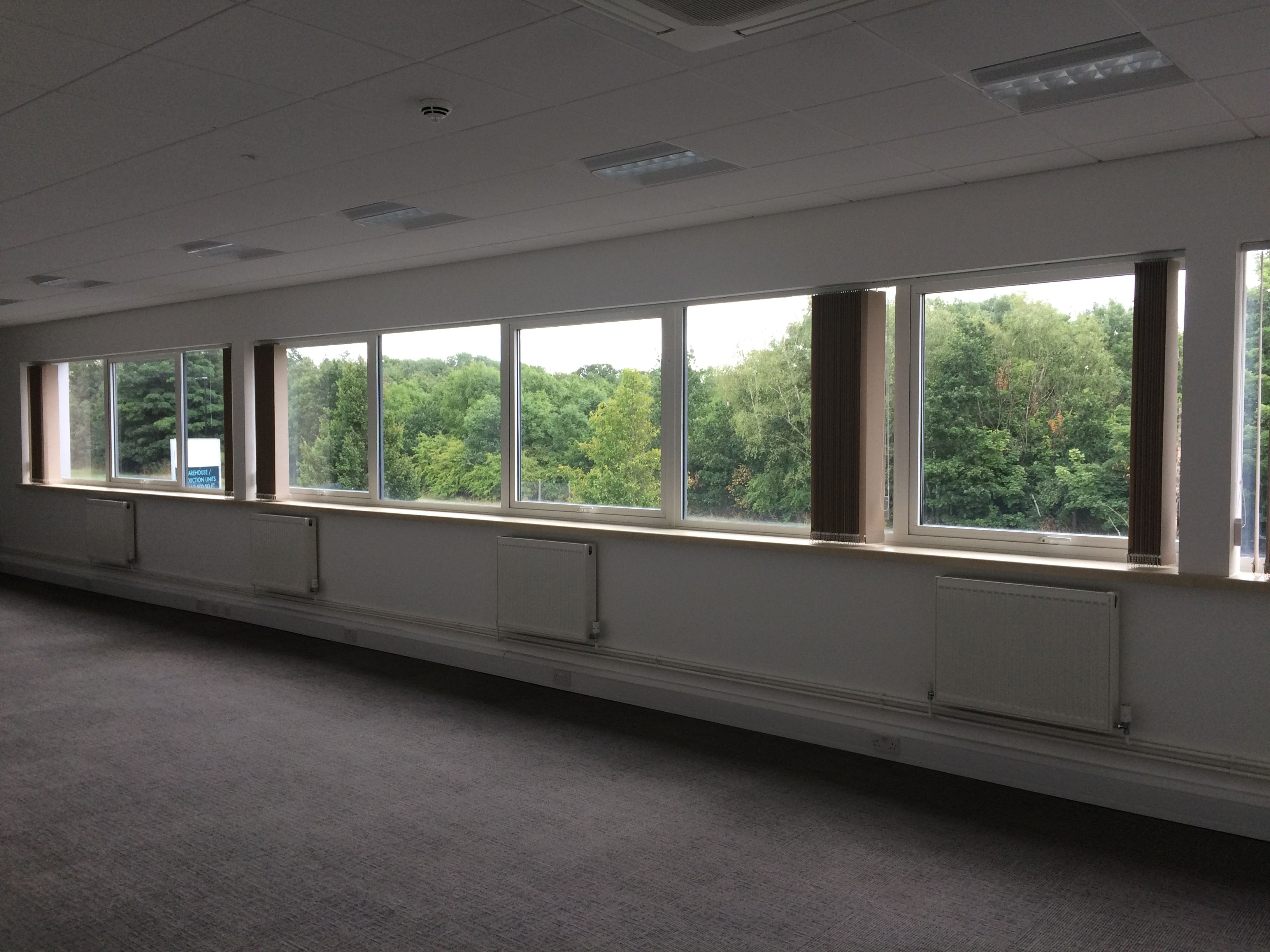 An installation of VLB vertical louvre blinds into warehouse offices.