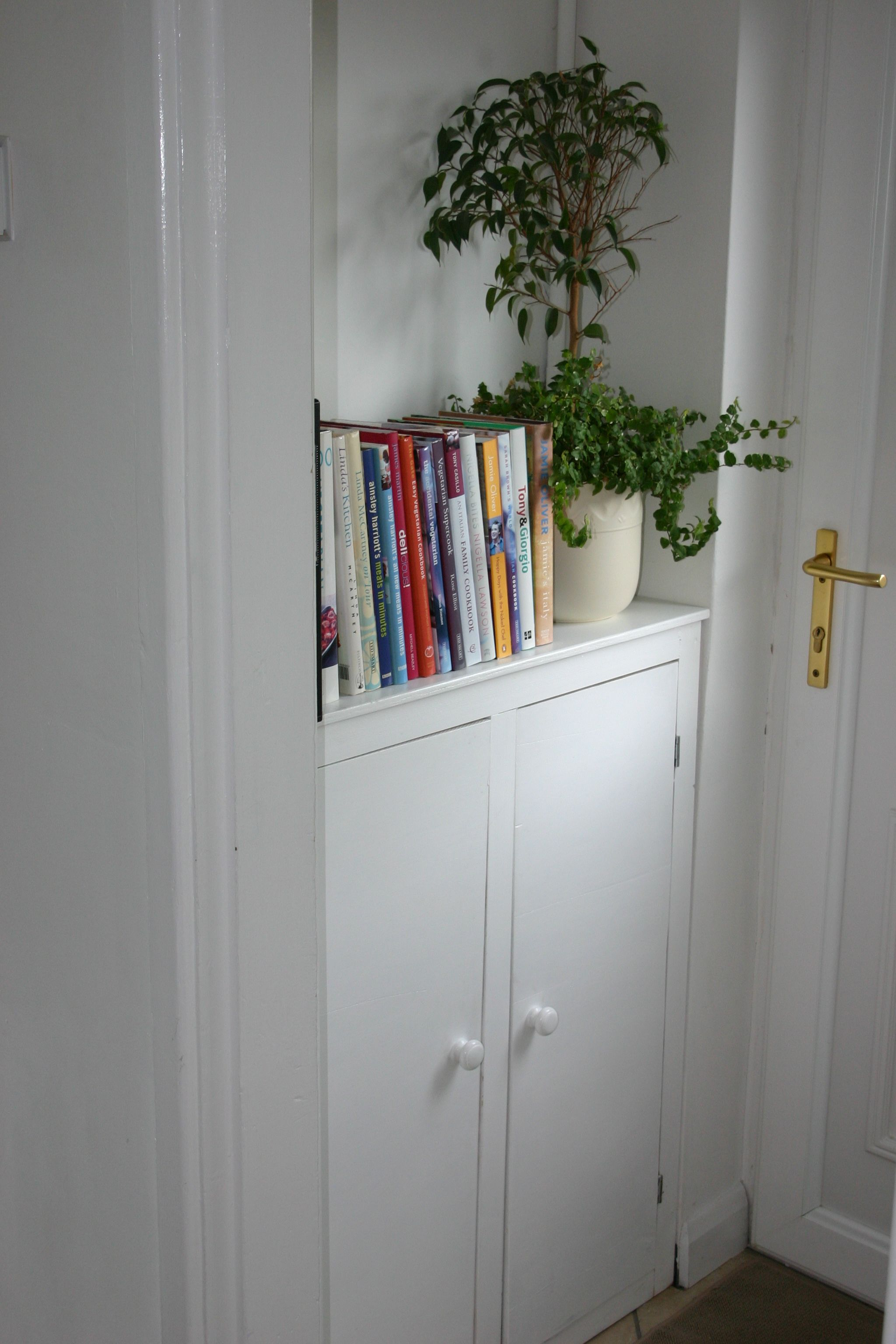 Hiding The Gas Meter With A Custom Built White Cabinet Also Added Storage For Ugly Cleaning