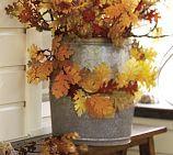 Barrel-shaped galvanized planter.