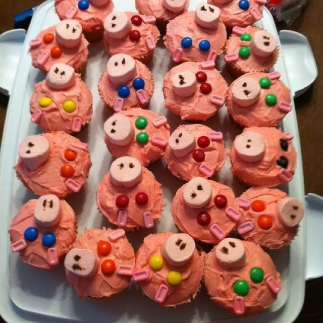 Strawberry cupcakes with strawberry icing, strawberry marshmallow nose, m eyes, pez ears, and chocolate icing dots for nostrils. Big hit at the birthday party.