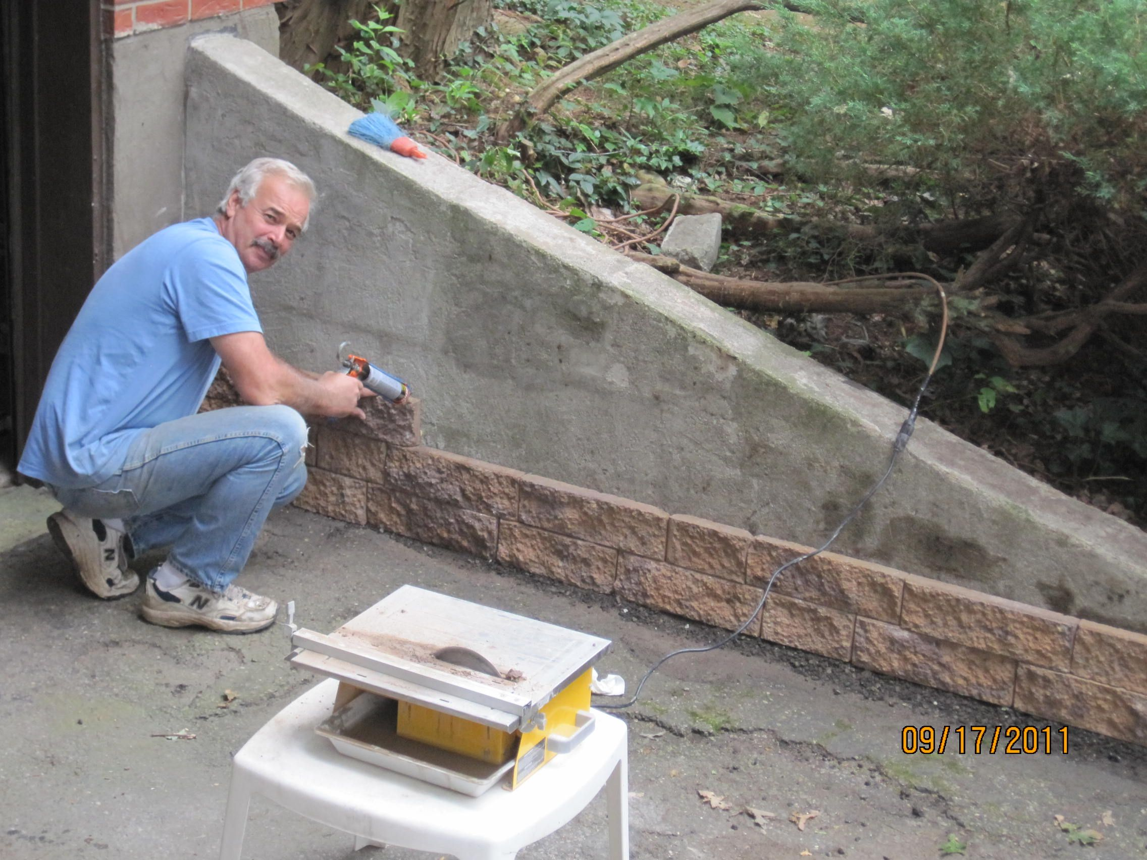 Great way to cover up this unsitely cement wall and - How to cover exterior cinder block walls ...