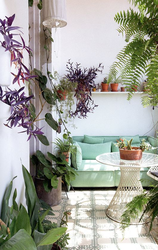 That Mint Green Couch Is The Perfect Piece For This Green Space