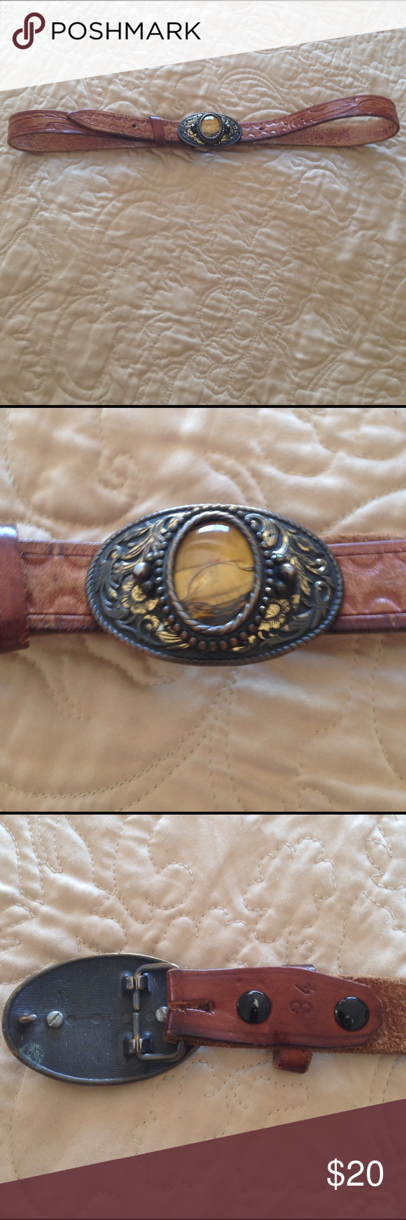 Vintage western boho belt Beautiful vintage belt leather tool the buckle is metal with a really pretty agate stone in the middle of it definitely old in good shape would be perfect for jeans or a really cute dress really cool statement piece measures 36 inches long the belt is stamped that says 34 Accessories Belts