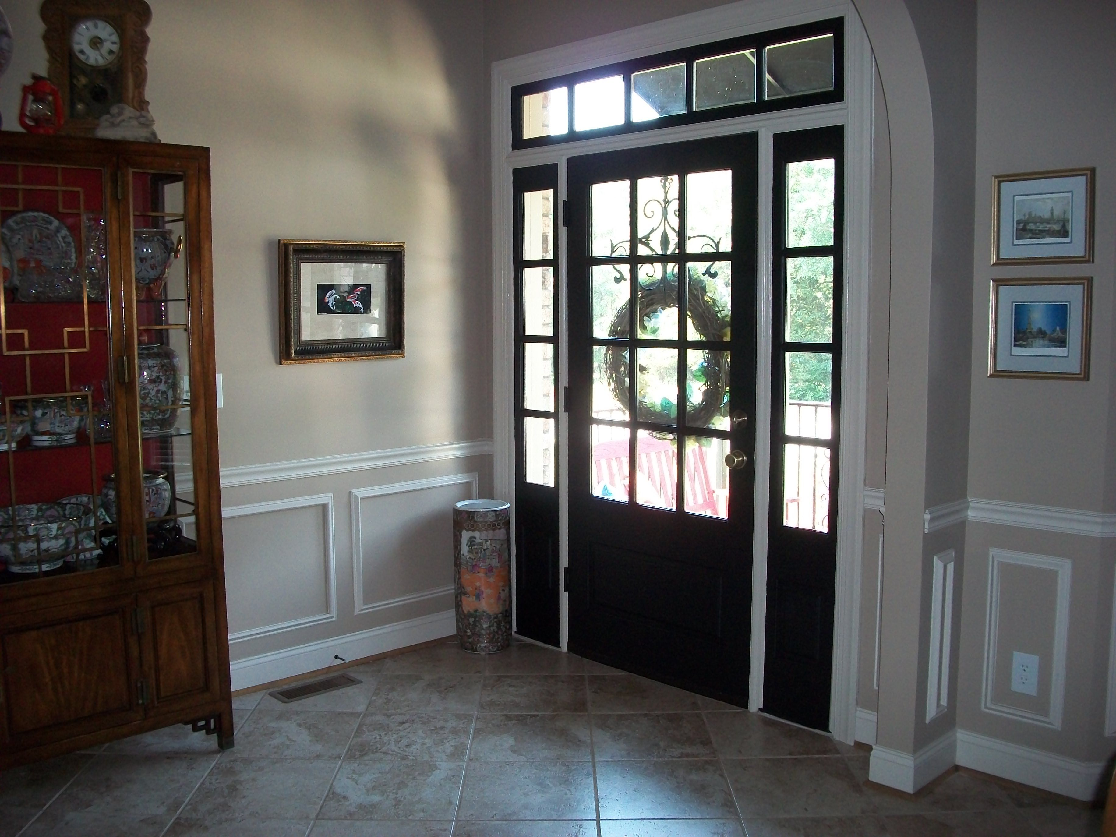 Open front door from inside - Painting The Front Door Adds Weight To An Open Entrance