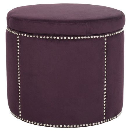 """Storage ottoman with nailhead accents.   Product: OttomanConstruction Material: Plywood and polyesterColor: WineFeatures:  Nailhead accentsRemovable top with hidden storage Dimensions: 18.9"""" H x 22"""" Diameter"""