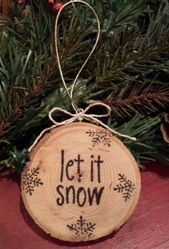 Photo of Lovely Christmas ornament. Pyrography wood slice. Would look grea