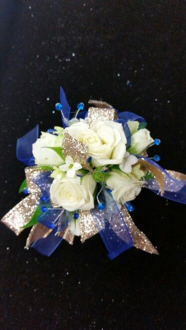 white spray roses with royal blue and gold accents prom