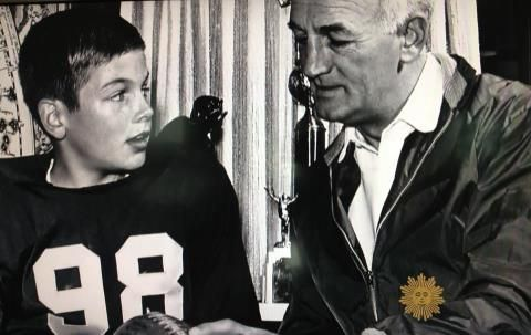 Ole #98, Tom Harmon, Michigan's first Heisman Trophy winner, giving pointers to his son Mark, who had a great college career at UCLA, and then went on to the movies and TV