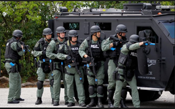 A police SWAT team stormed a home Friday evening after a woman was