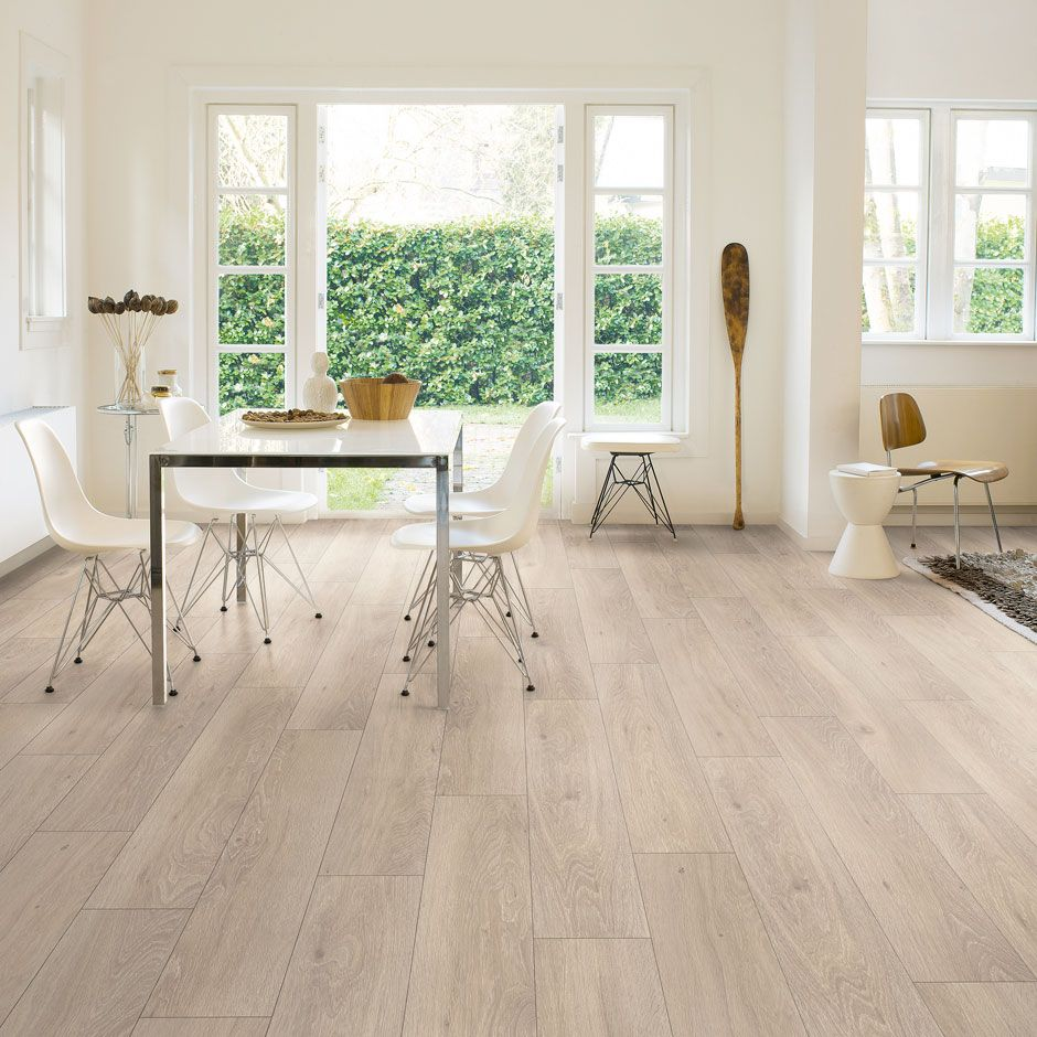 Brighten up your home or office with the Quickstep Classic moonlight oak  light laminate flooring. Each one of the extra wide, smooth oak effect  planks fit ...
