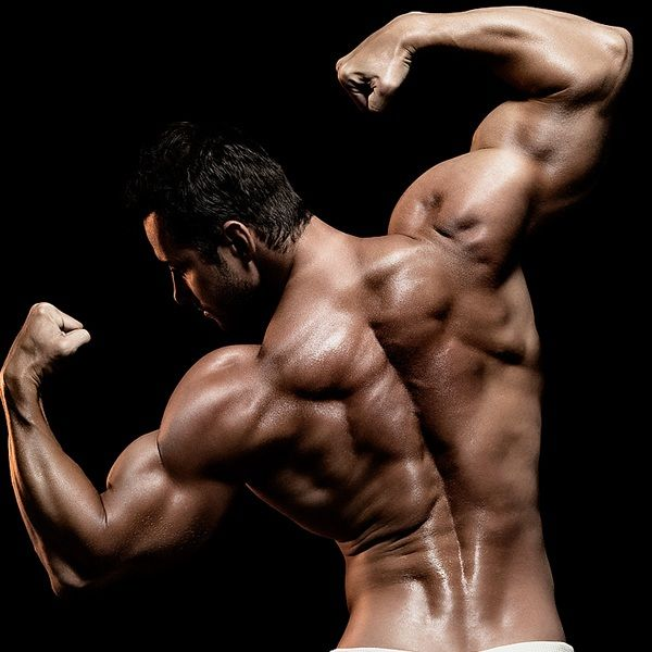 Full deltoid development and thick rhomboids. Only achieved with ...