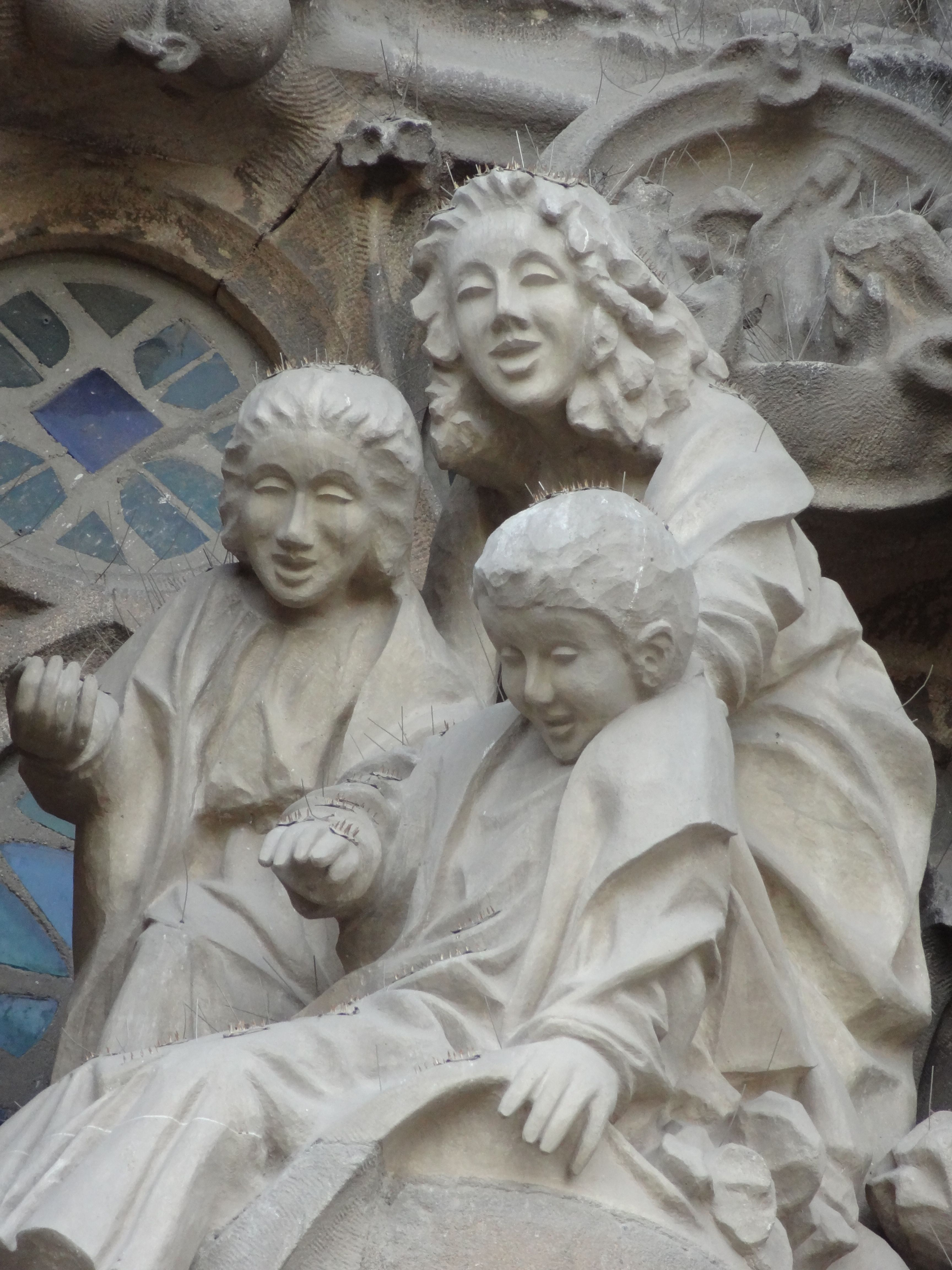 Nativity entrance to Basilica de la Sagrada Familia in Barcelona, Spain. One artist restoring the fascade is Japanese, so the angels have Asian faces. Love the diversity!