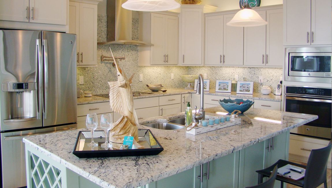 Seafoam Kitchen Island With White Cabinets In Pensacola, Florida #DRHorton