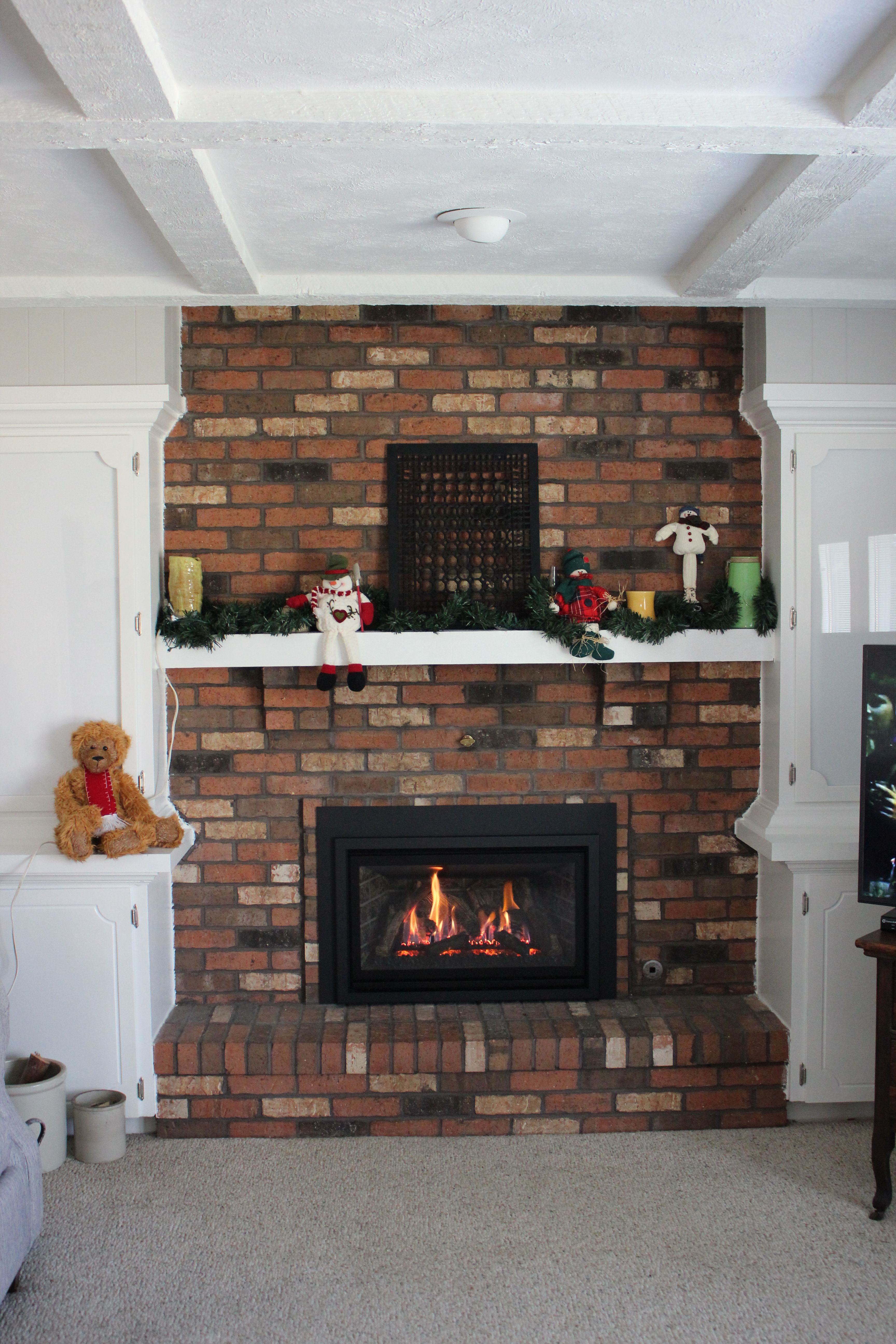Adding an insert to an old masonry fireplace might be just