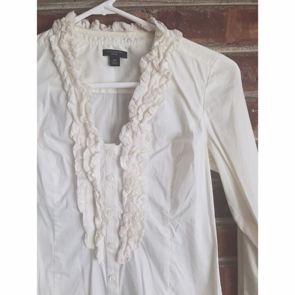 ⚡️SALE $5⚡️Ann Taylor Petite Ruffle Top - size 0P Ann Taylor brand ruffle detail, white, button-down shirt. 68% cotton, 28% nylon and 4% spandex. Features long sleeves and v-neck with ruffle trim. In gently used condition - no signs of wear. No trades and no modeling. Price will go back up to $10 after sale ends. Ann Taylor Tops Button Down Shirts
