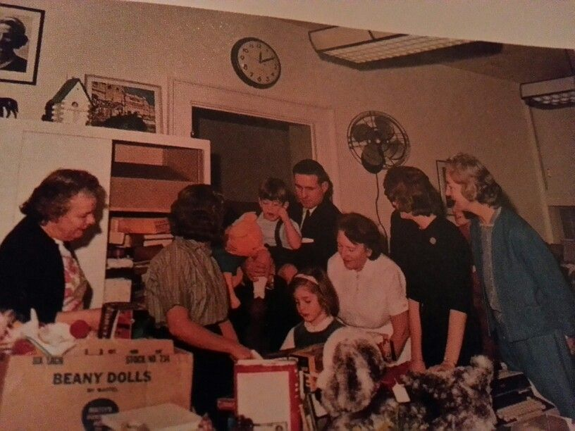 Caroline and John picking out a toy on their last day at the Whitehouse.Agent Bob Foster is holding John.