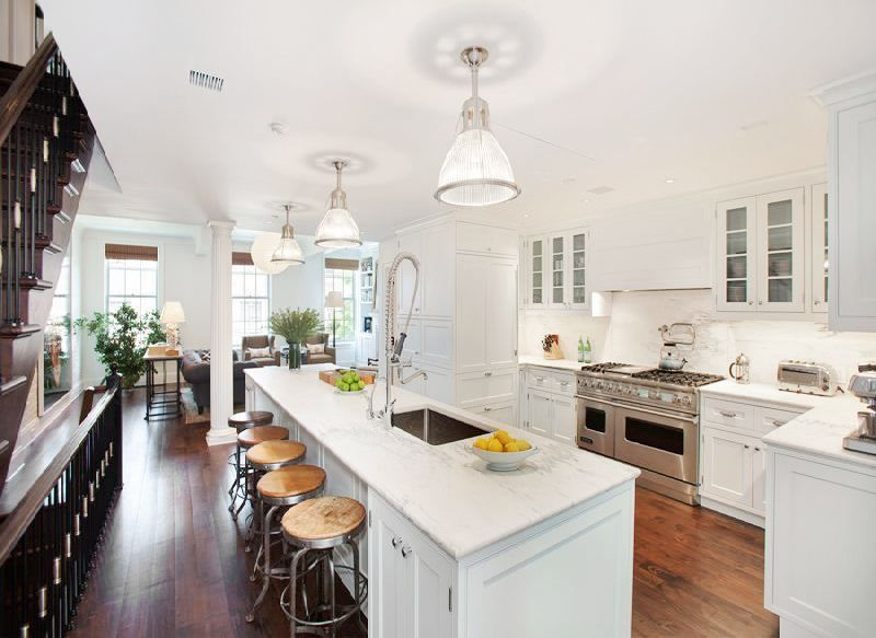 love marble! but i especially love the industrial stools against the refined look of this island!