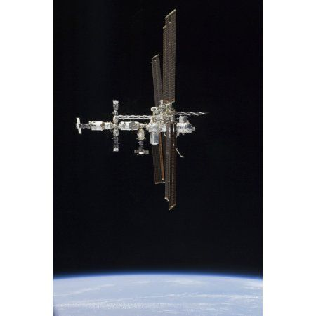 The International Space Station in orbit above Earth Canvas Art - Stocktrek Images (23 x 34)