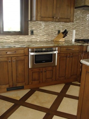Great kitchen floor pattern using porcelain wood look tiles and ...