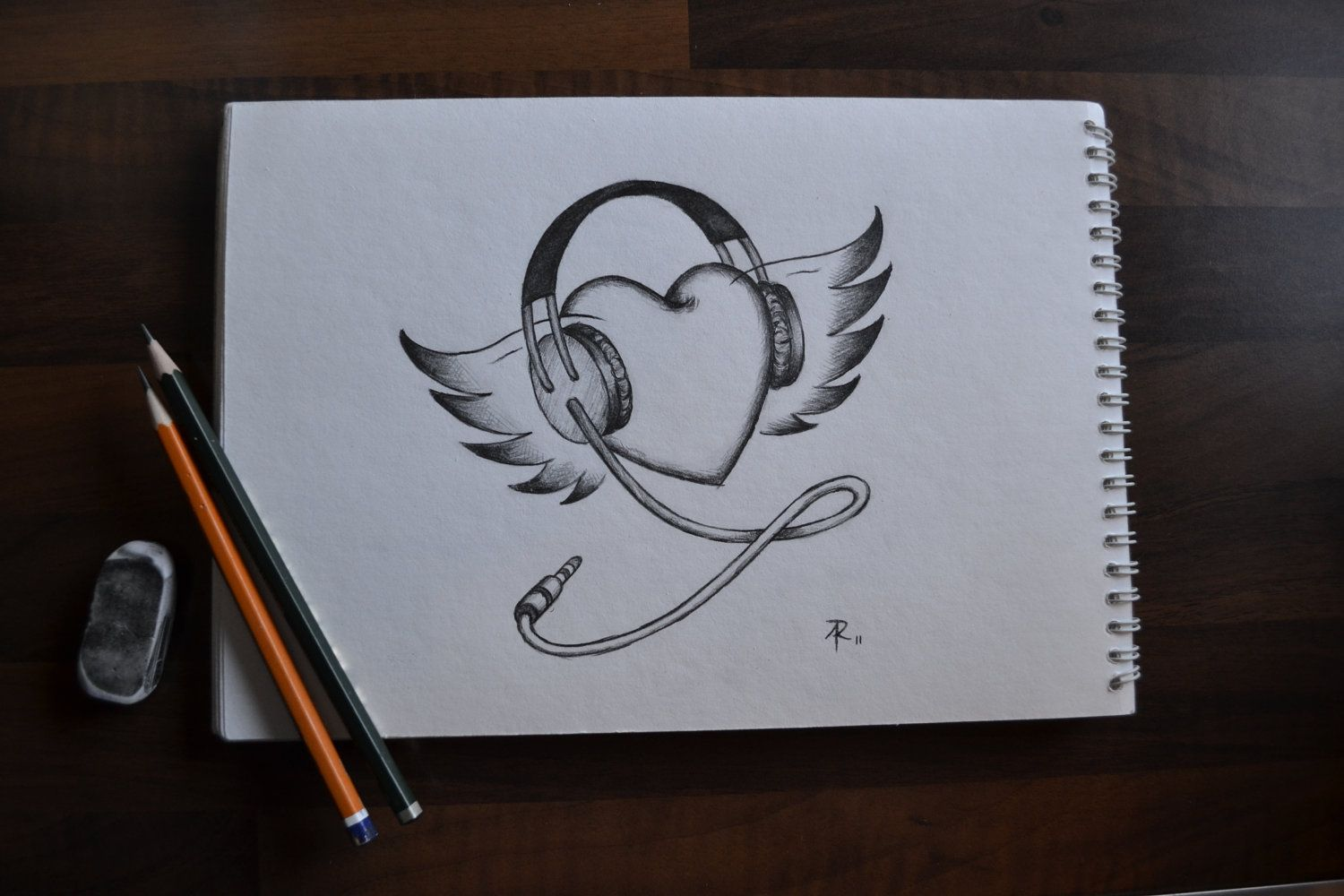 Heart with wings and headphones drawing