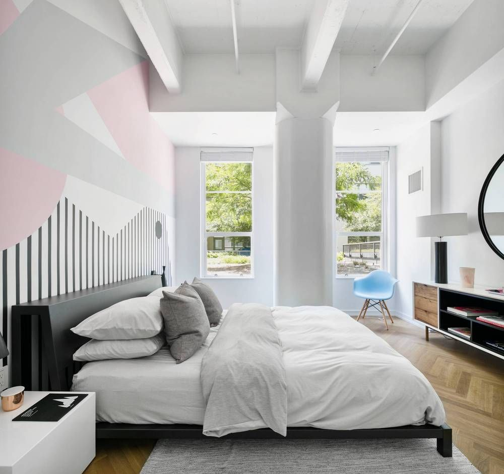 Austin nichols house black and white room with pink accents wall mural behind black bed